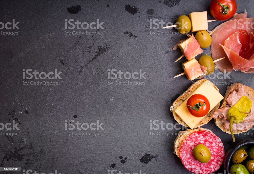 Spanish tapas on a black stone background stock photo