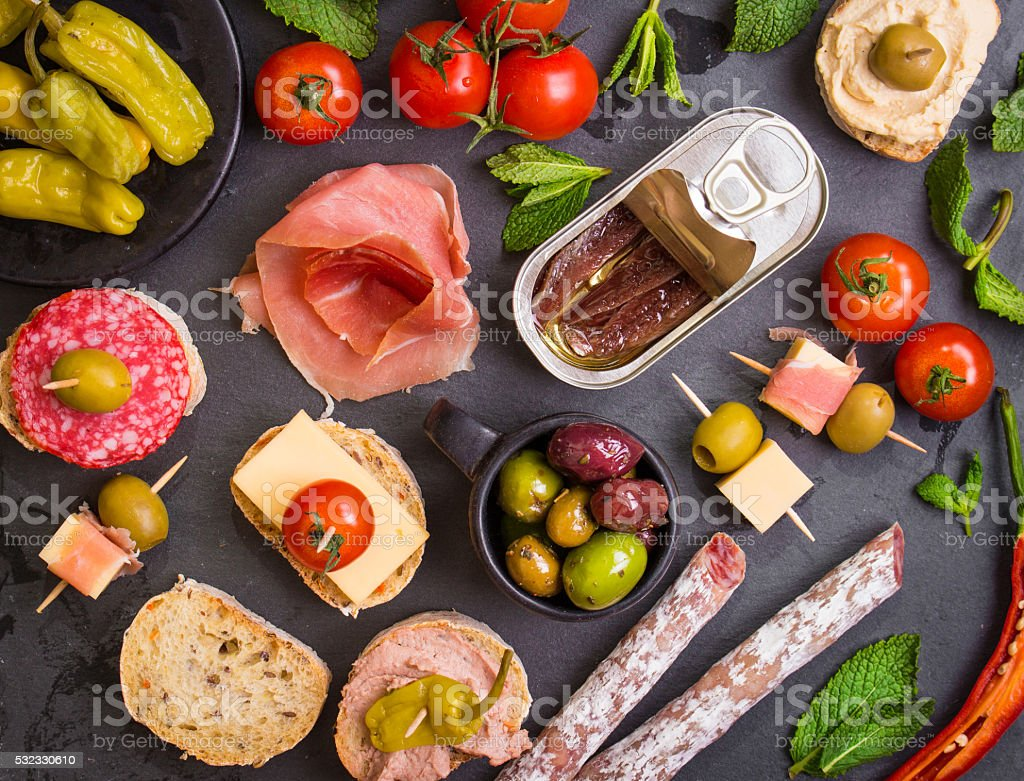 Spanish tapas on a black stone stock photo