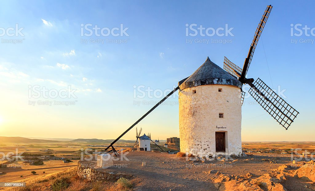 Spanish windmills at sunset stock photo