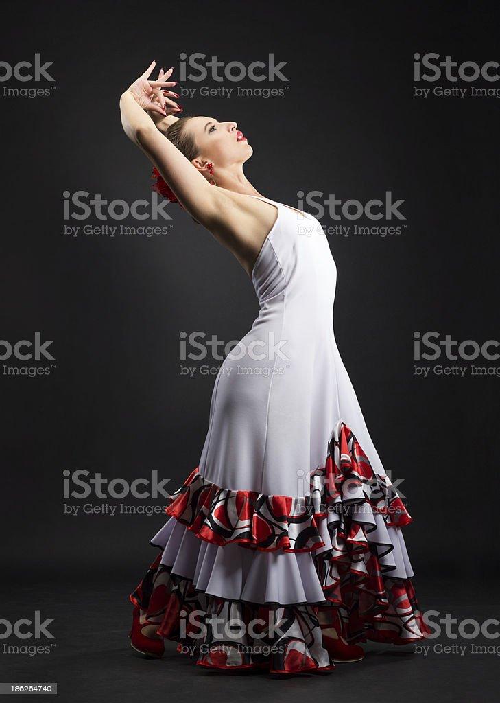 Spanish woman dancing flamenco on black royalty-free stock photo