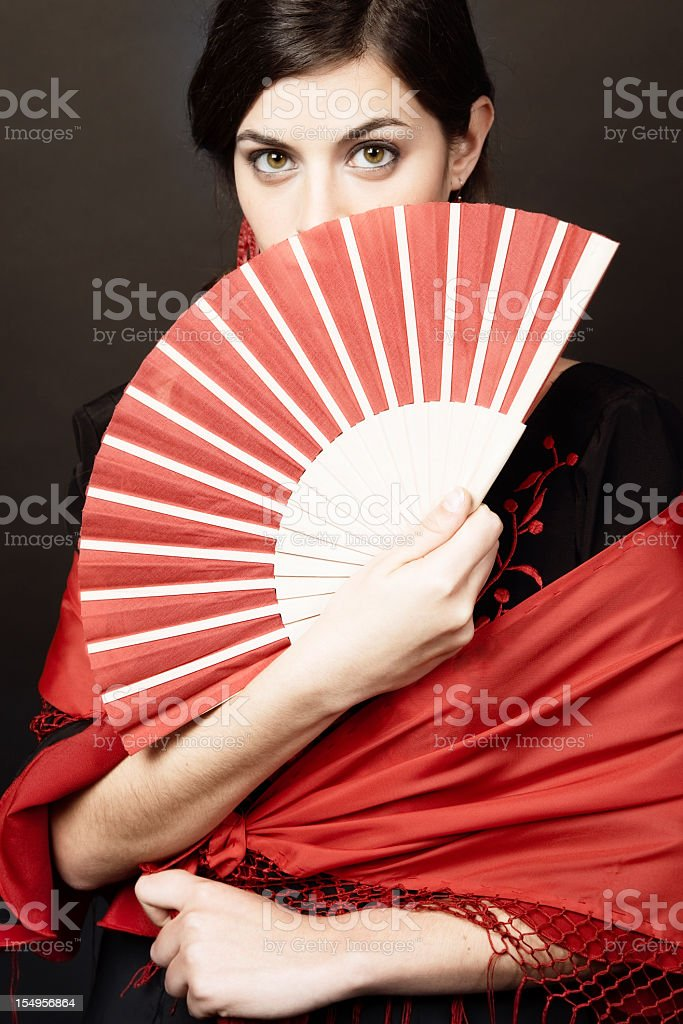 Spanish woman looking at camera with a sensual glance stock photo