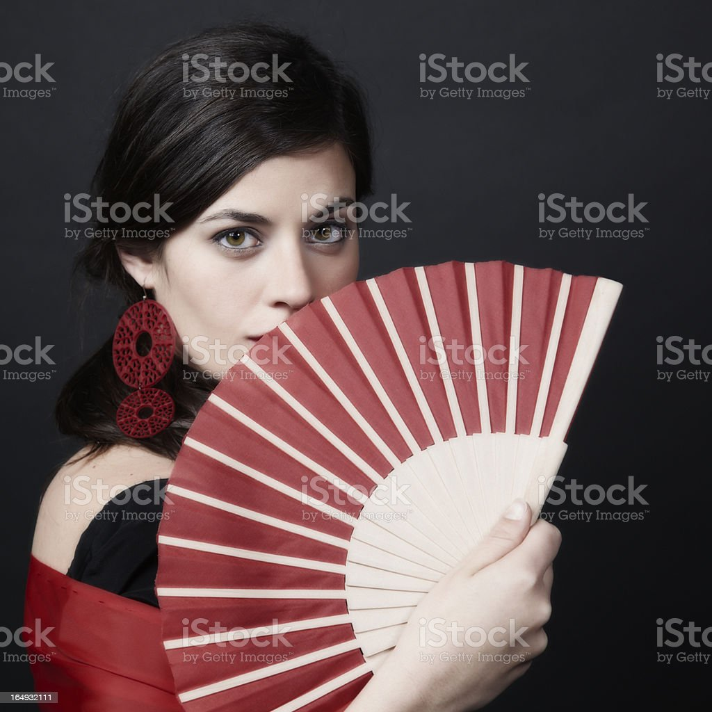 Spanish woman looking sideways with a sensual glance stock photo