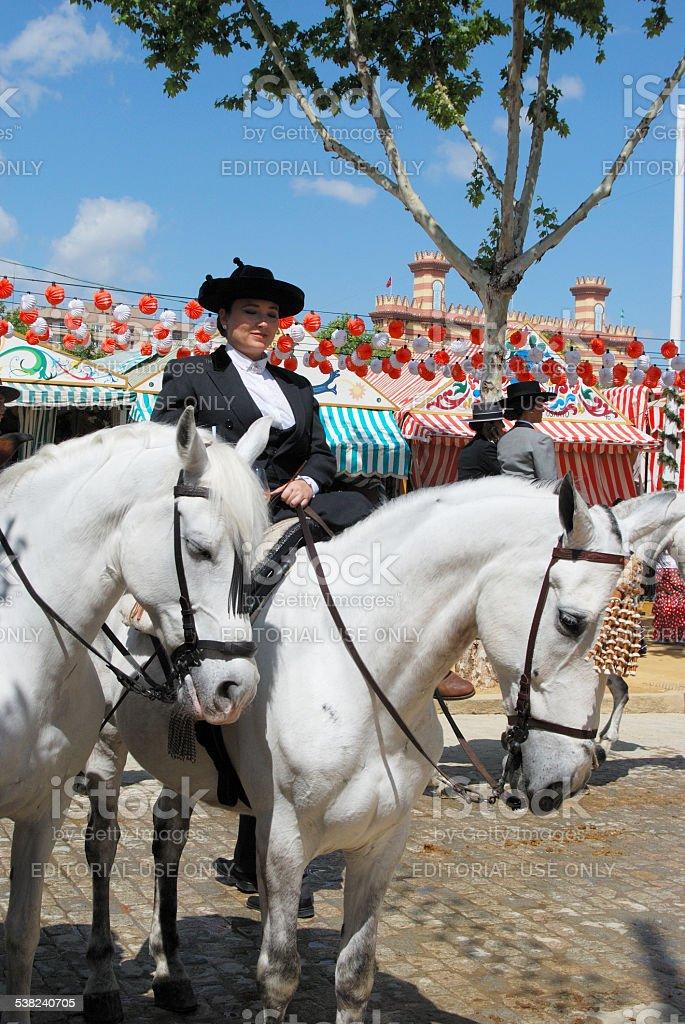 Spanish woman on a horse, Seville. stock photo