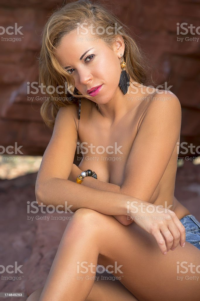Spanish woman topless in the desert royalty-free stock photo