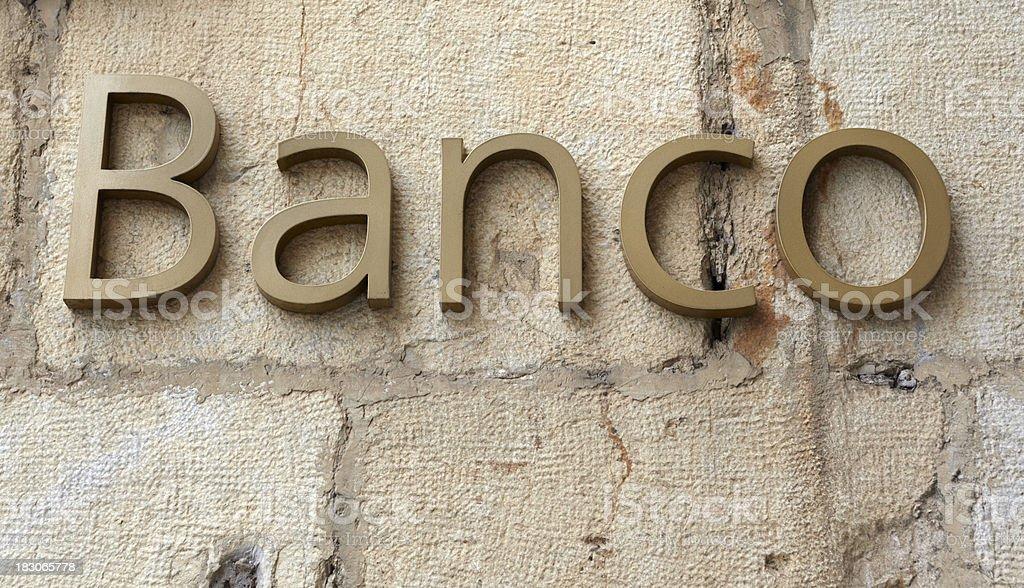 Spanish word Banco on stone wall stock photo