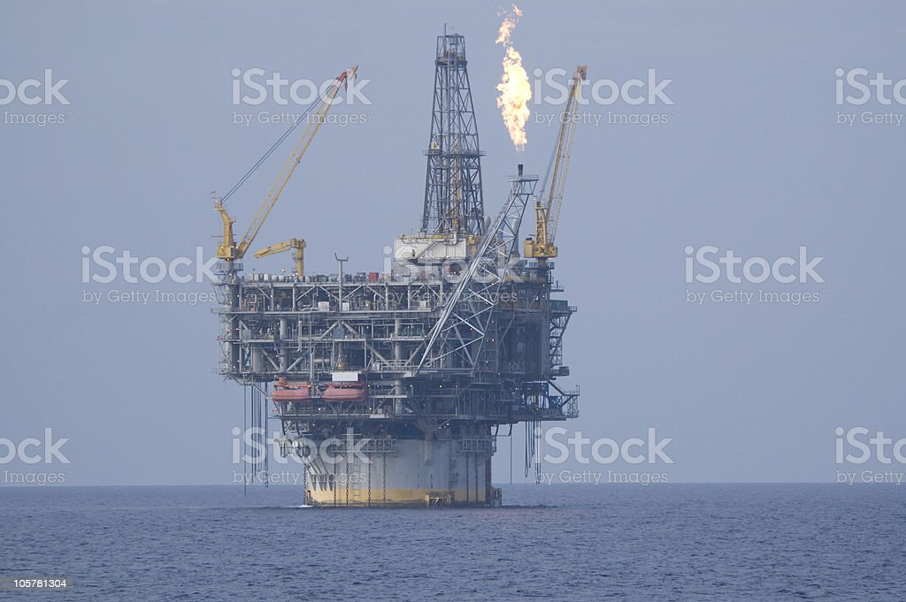 Spar oil rig with flare. Production platform royalty-free stock photo