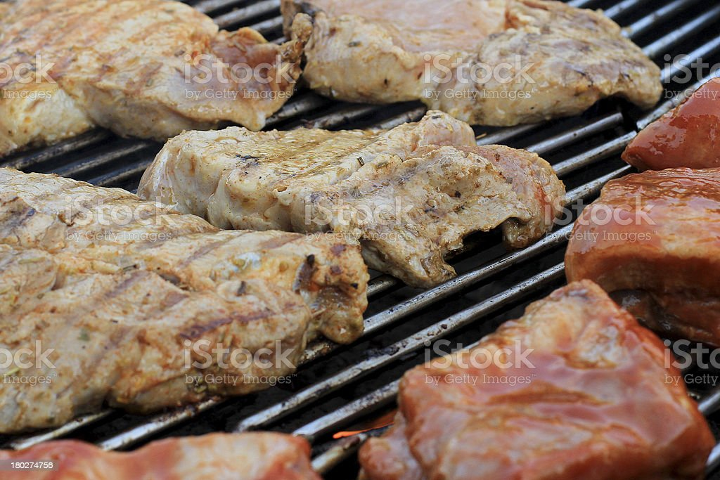 Spareribs and shoulder on grill royalty-free stock photo