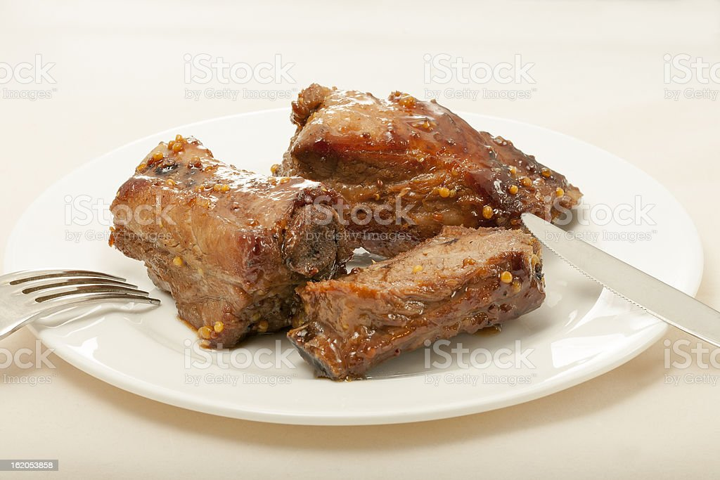 spareribs cooked in mustard and honey sauce royalty-free stock photo