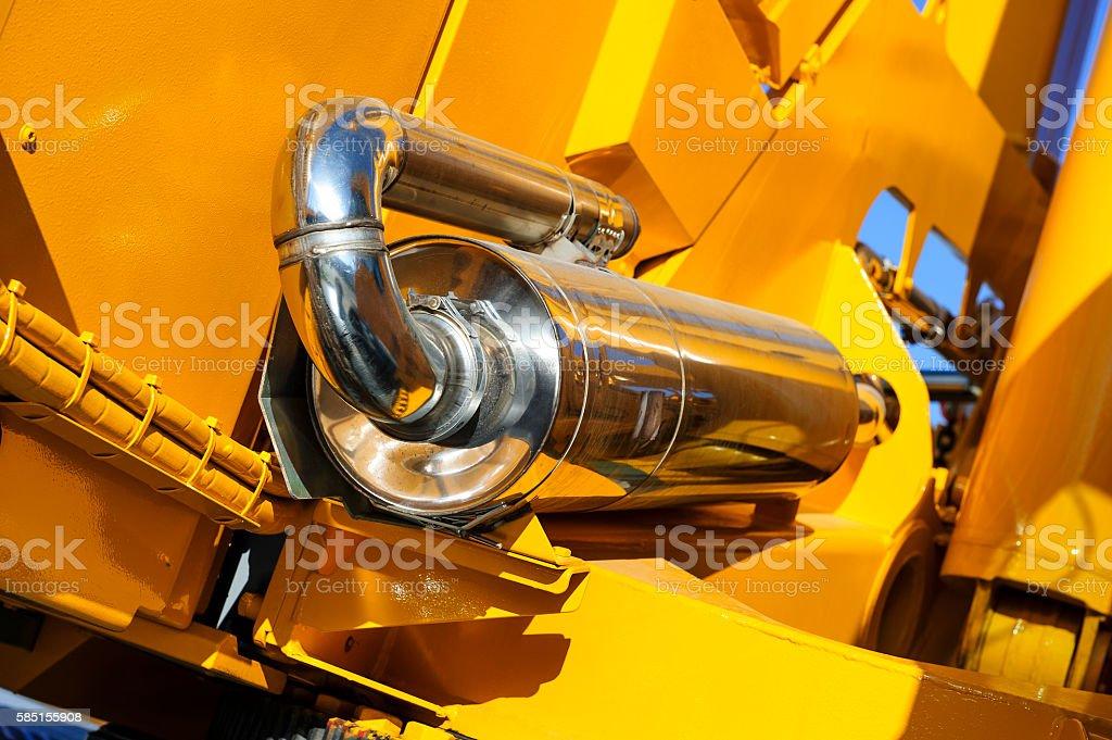 Spark arrestor of construction machine stock photo