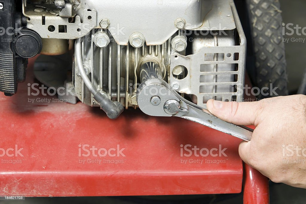 Spark Plug Removal from a Small Gasoline Engine royalty-free stock photo