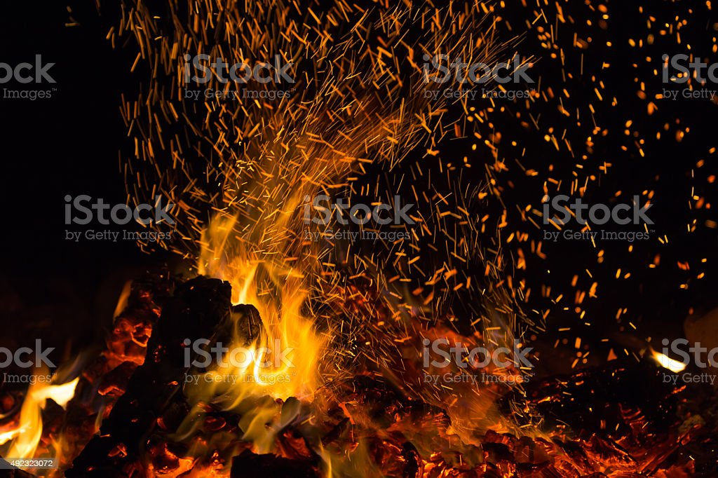 Sparking bonfire close-up at night stock photo