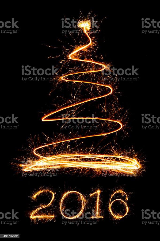 Sparkle firework Christmas tree and text stock photo