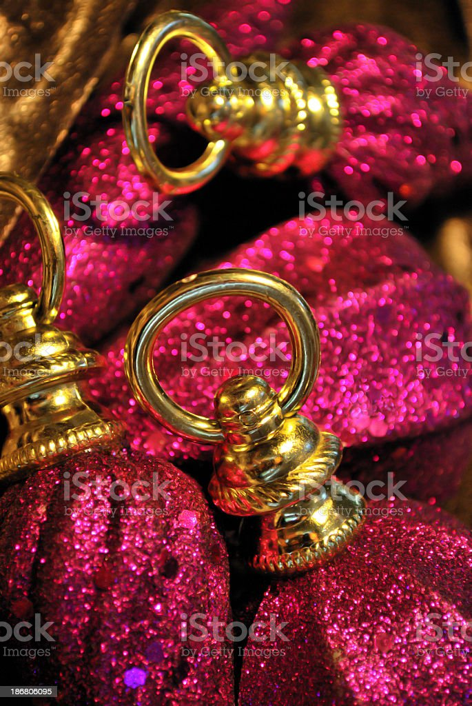 Sparkle Gold Ringed Iridescent Magenta Christmas Ornaments stock photo