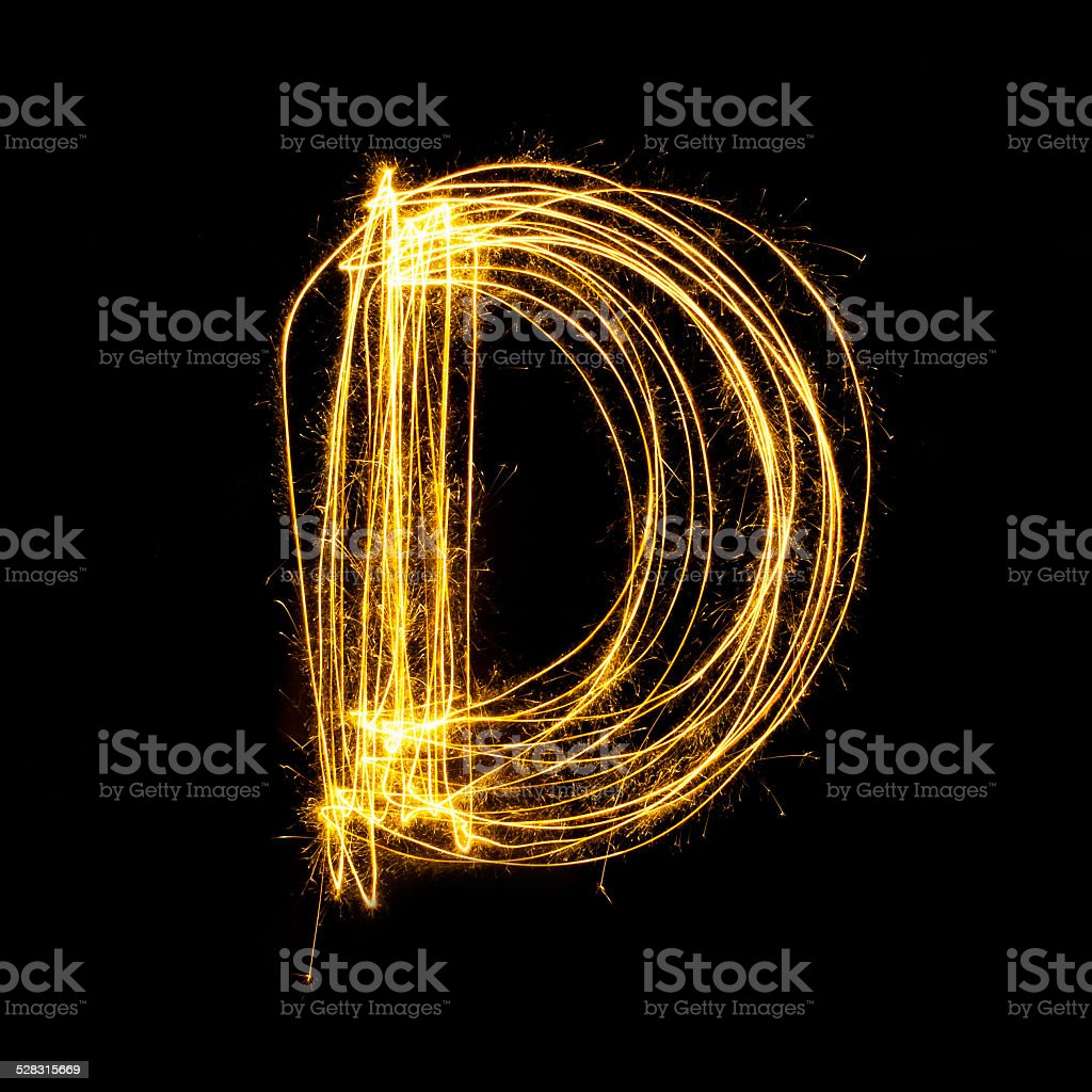Sparkler firework light alphabet D. stock photo