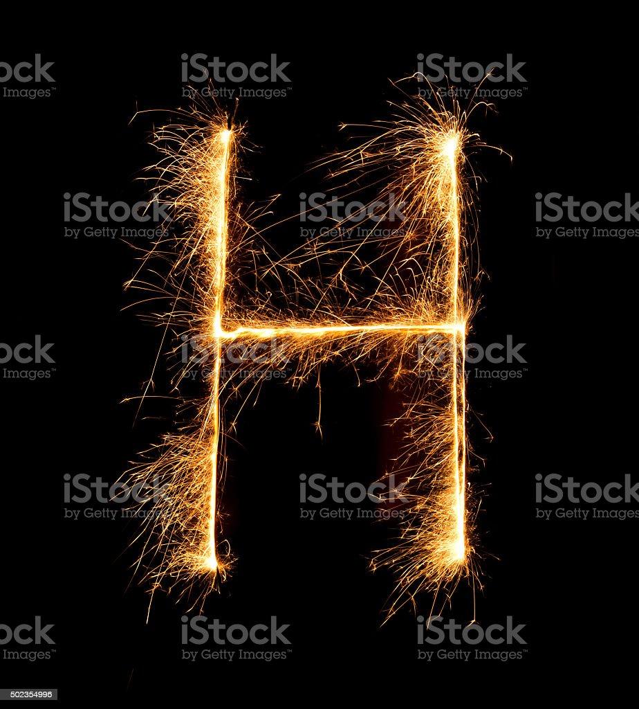 Sparkler firework light alphabet H (Capital Letters) at night stock photo