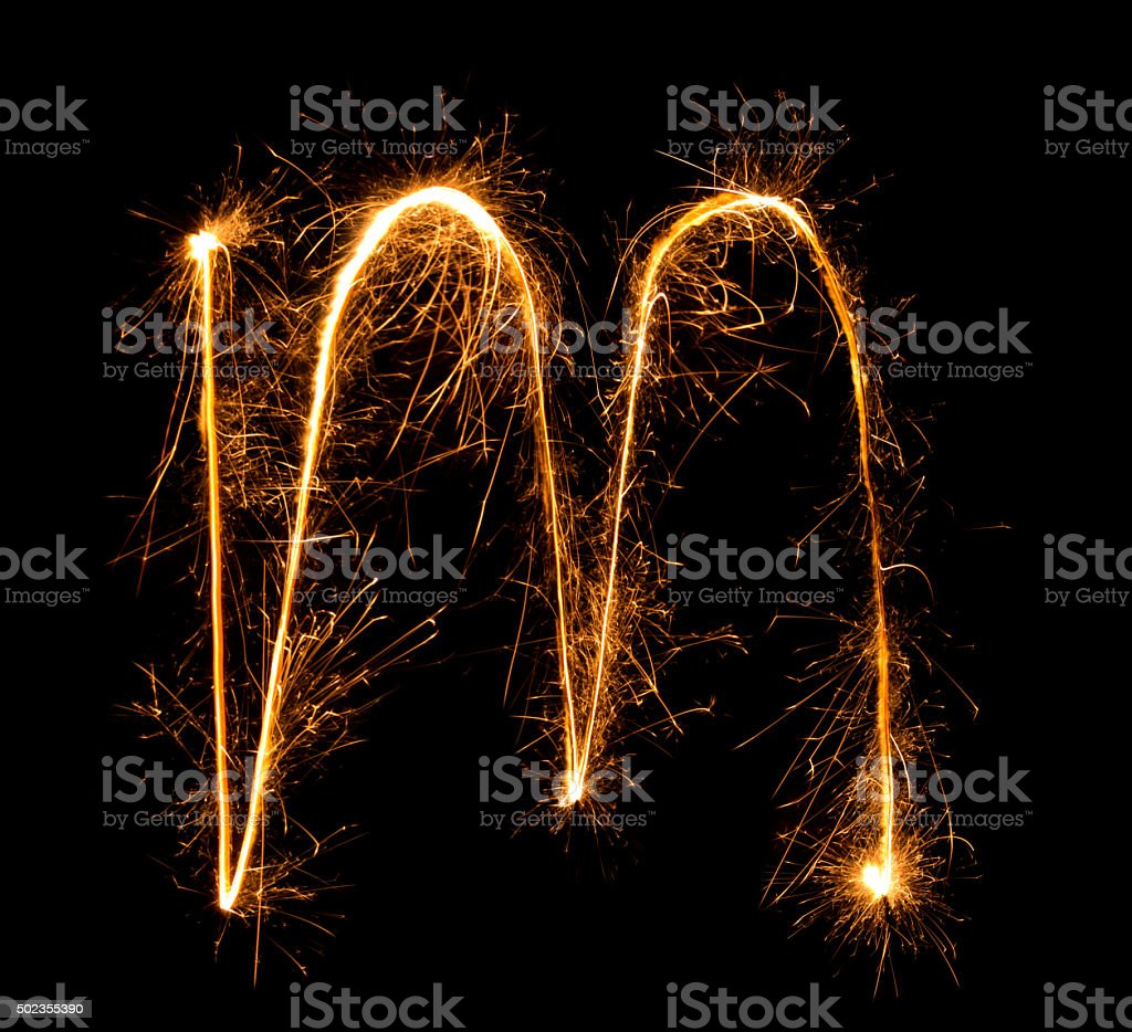 Sparkler firework light alphabet m (Small Letters) at night stock photo