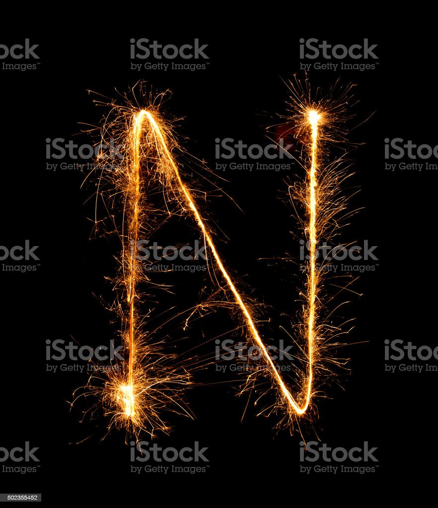 Sparkler firework light alphabet N (Capital Letters) at night stock photo
