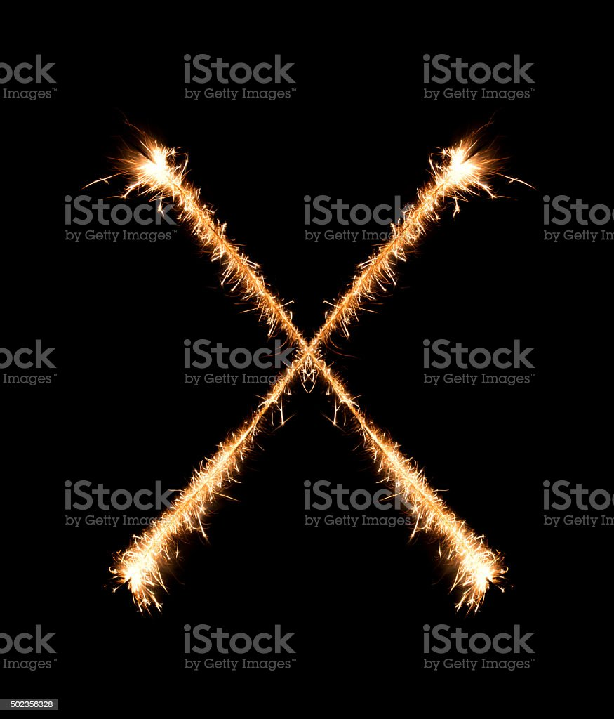 Sparkler firework light alphabet X at night stock photo
