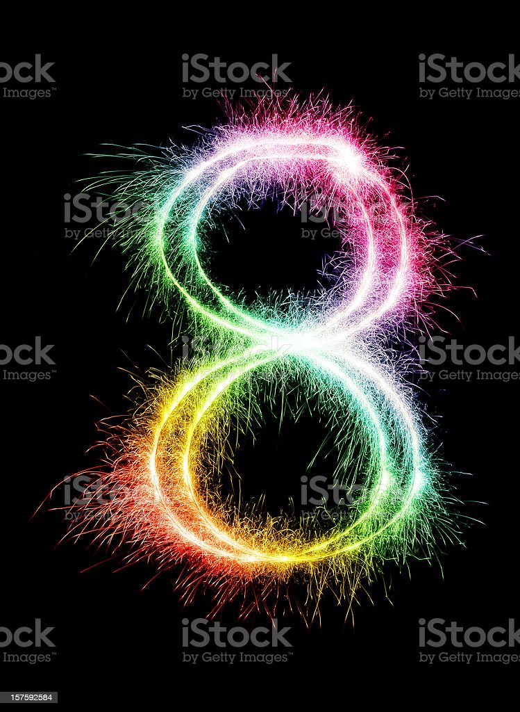A sparkler forming the number 8 in a rainbow color royalty-free stock photo