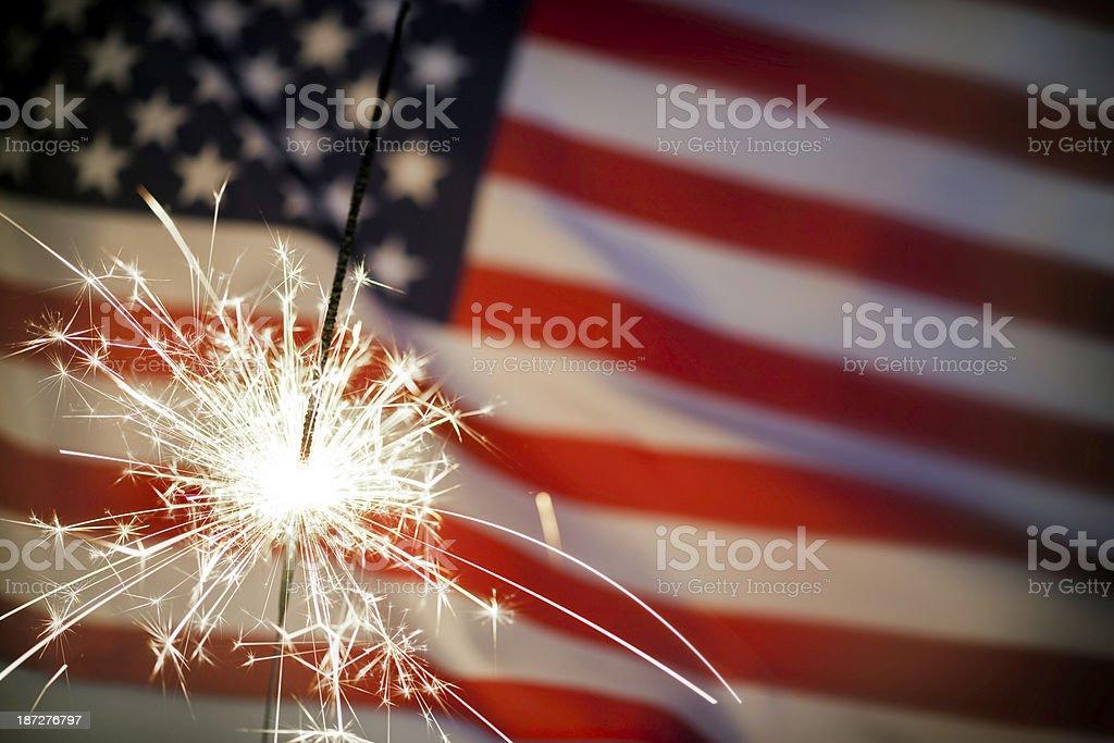 Sparkler Infront Of American Flag stock photo