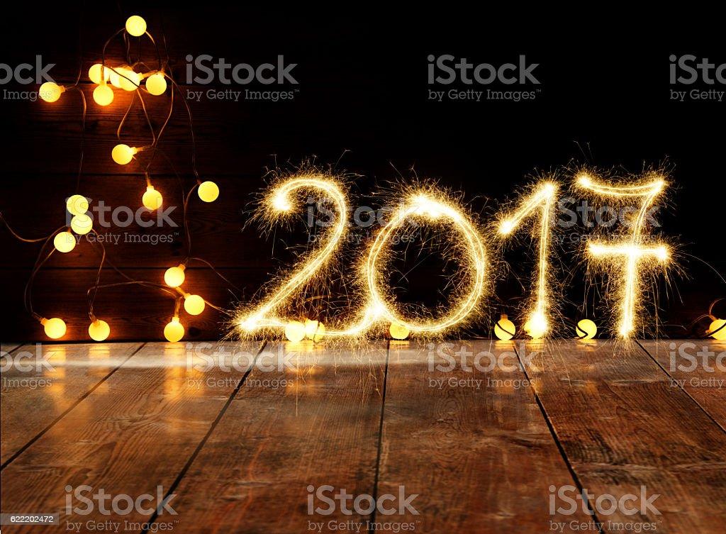 Sparkler New Year 2017 On Wooden Floor stock photo