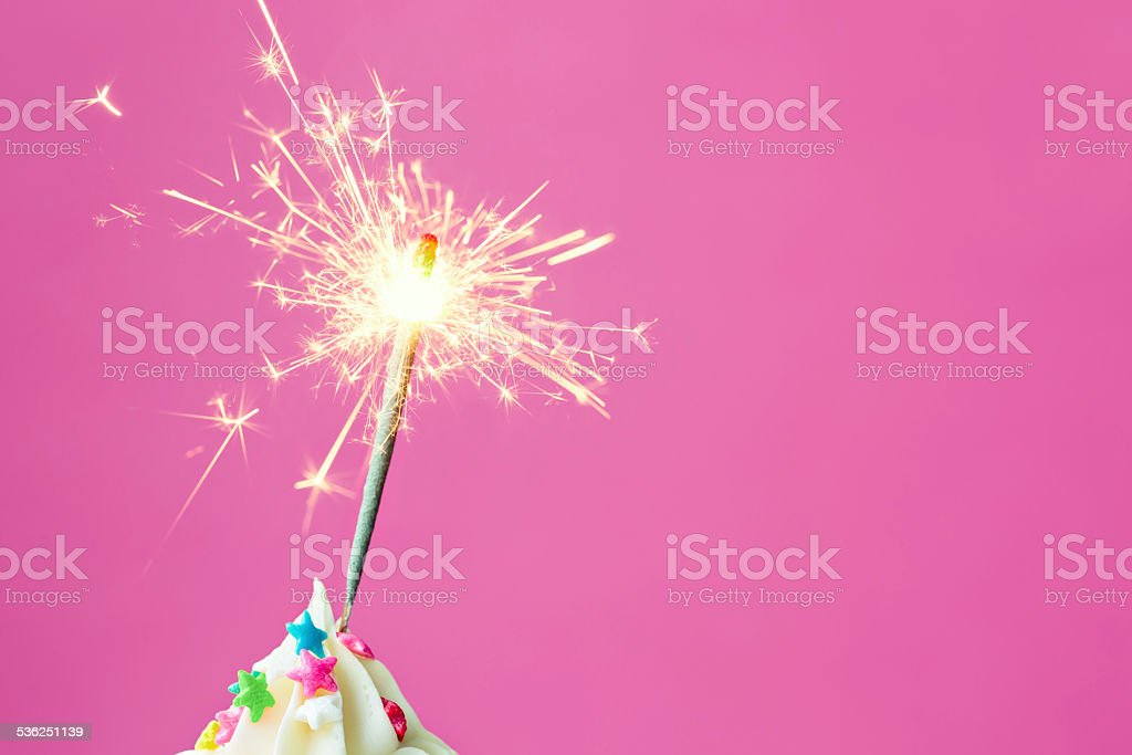 Sparkler on a cupcake stock photo