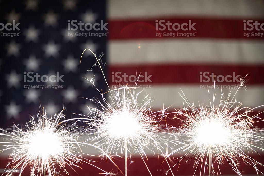 Sparkler with American Flag stock photo