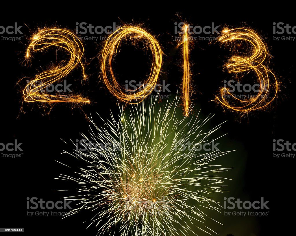 Sparklers above fireworks explosion 2013 royalty-free stock photo