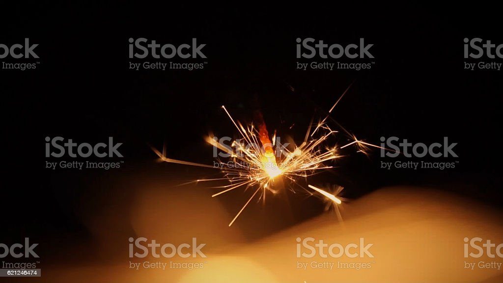 Sparkles like fireworks in the night stock photo