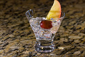 Sparkling beverage on ice with fruit