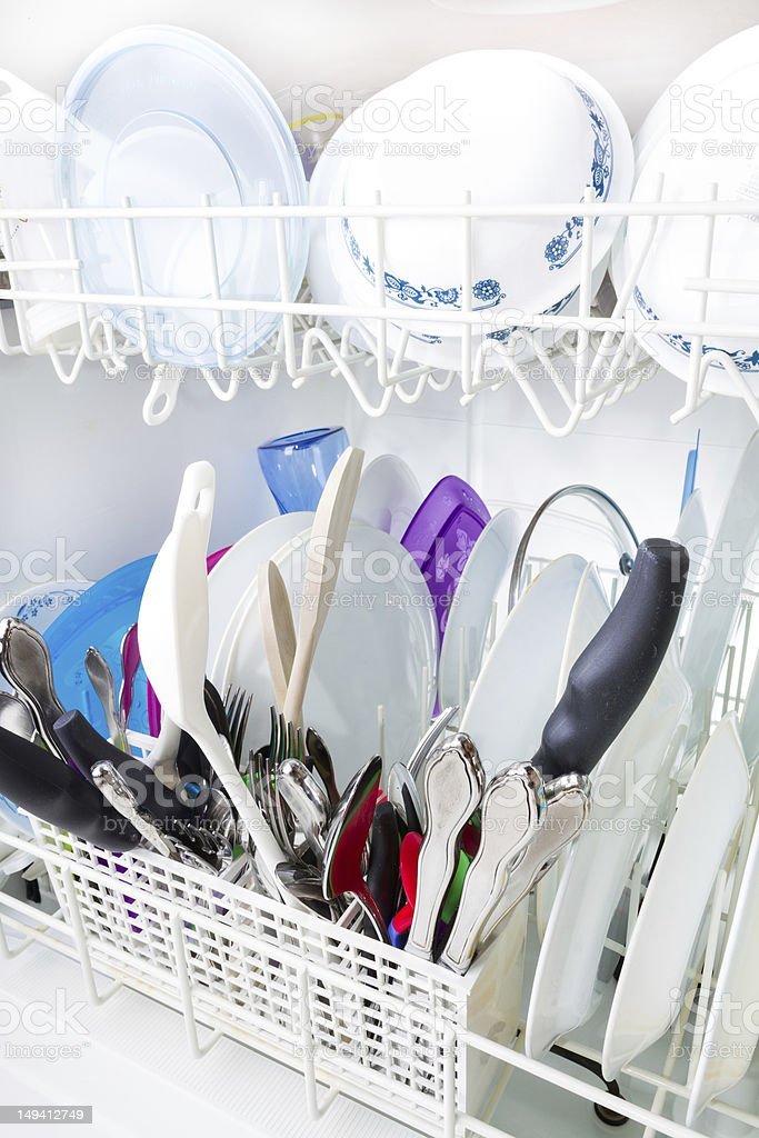 Sparkling clean dishes in the dishwasher stock photo