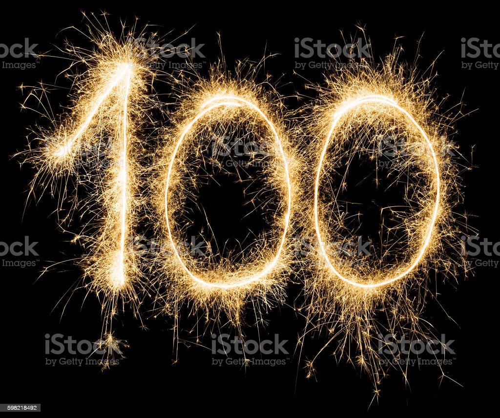 Sparkling golden celebration number one hundred 100th birthday stock photo