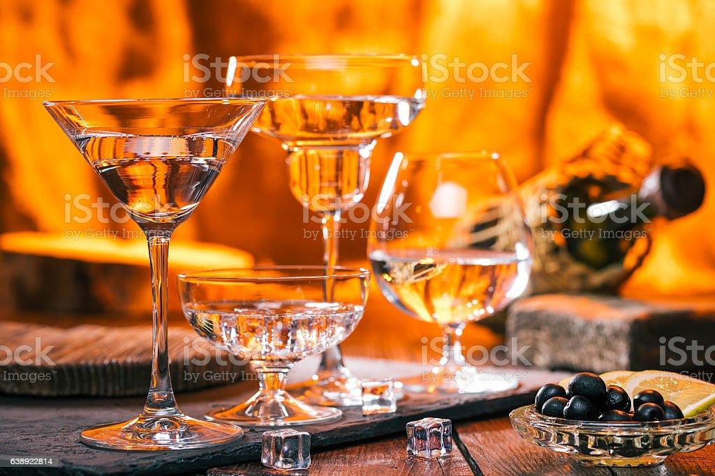 Sparkling liquid in variuos glasses stock photo