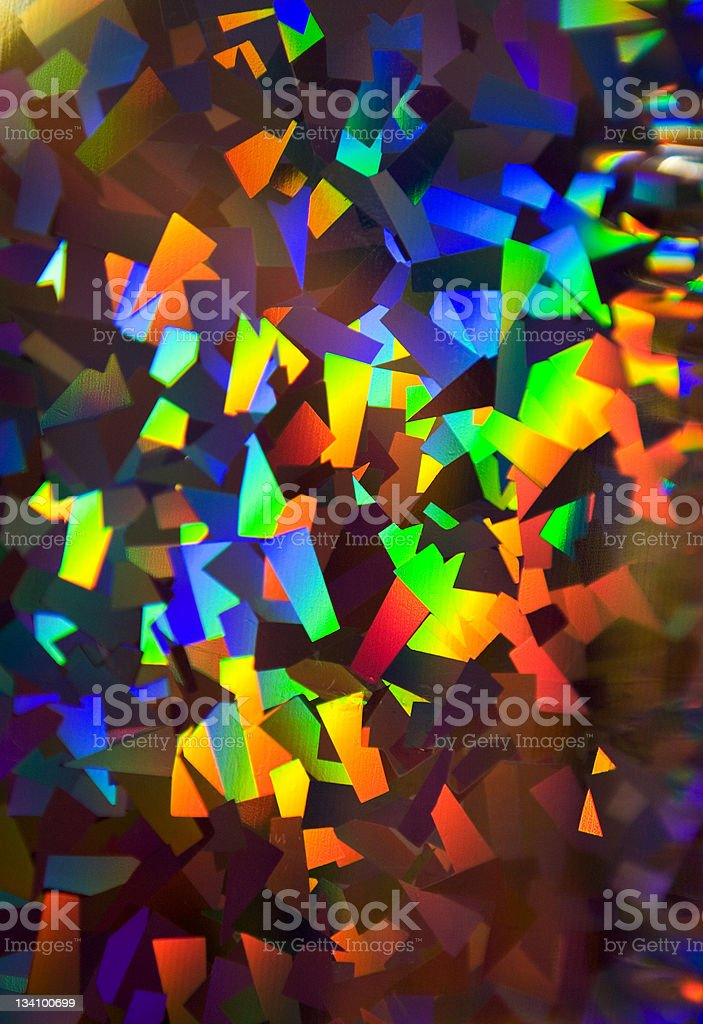 Sparkling multicolored holographic wrapping paper stock photo