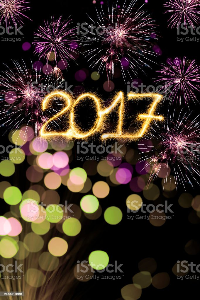 Sparkling New Year 2017 and fireworks stock photo