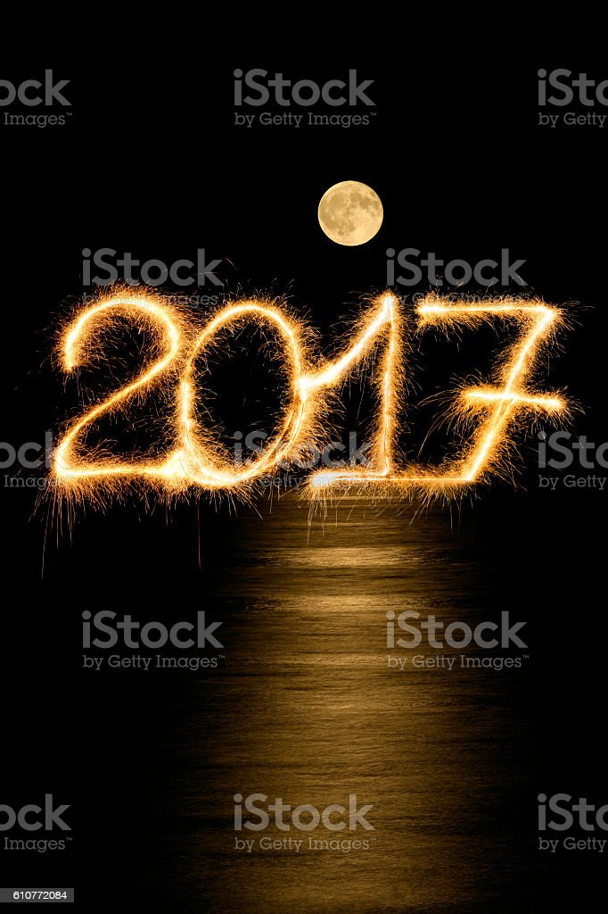 Sparkling New Year 2017 and full moon stock photo