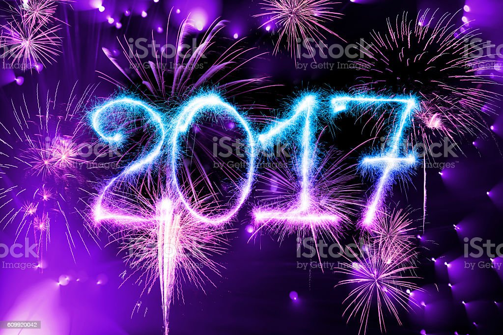 Sparkling New Year 2017 (with fireworks) stock photo