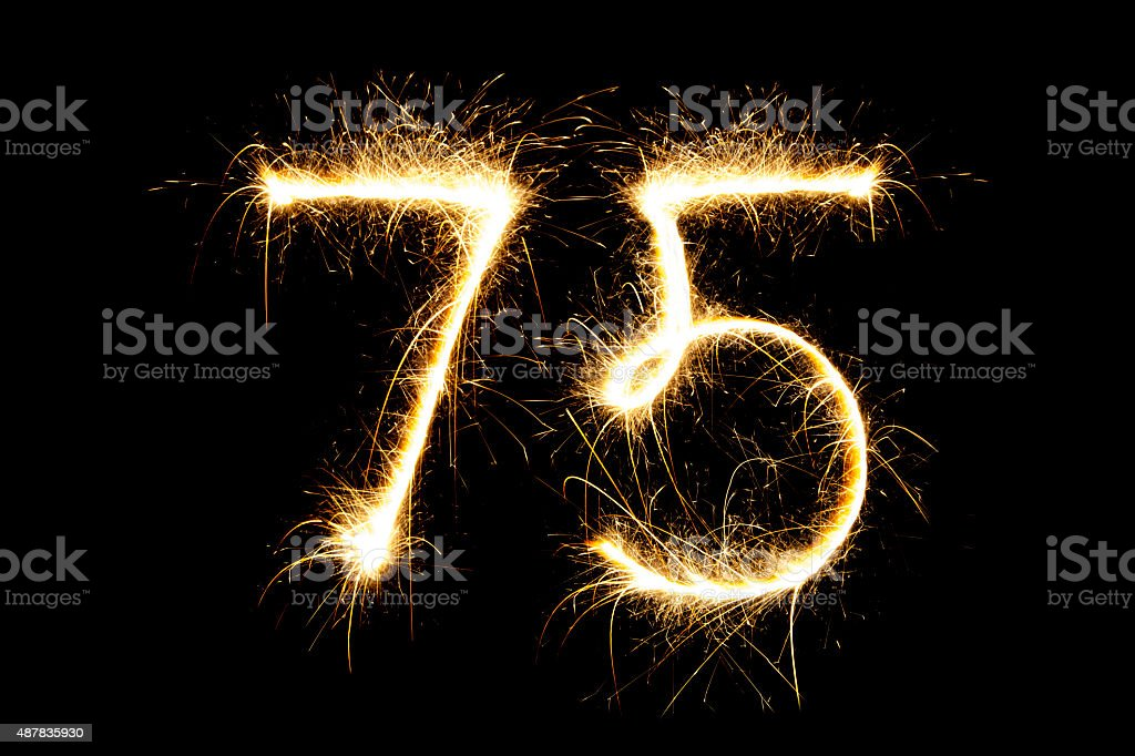 Sparkling number 75 stock photo