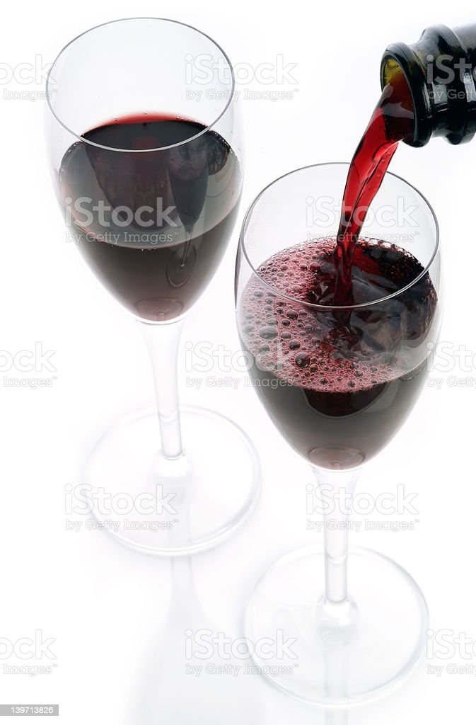 Sparkling red Shiraz being poured in to Champagne flutes royalty-free stock photo