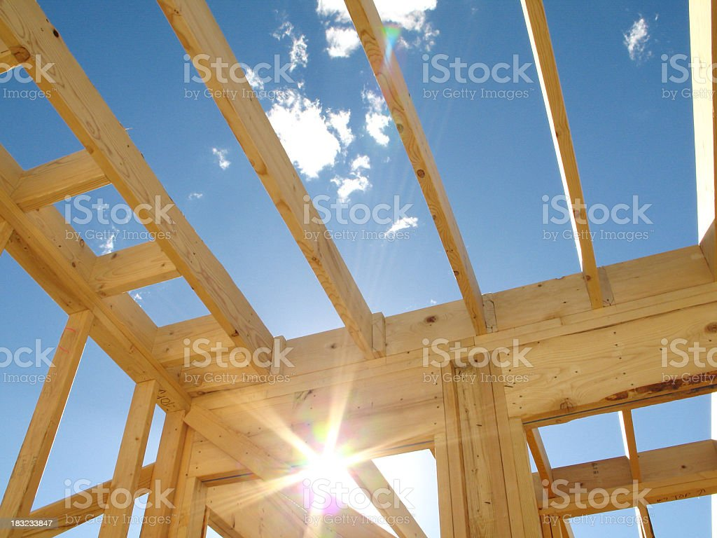 Sparkling Sunlight Framed Within Residential Wood Construction Framing stock photo