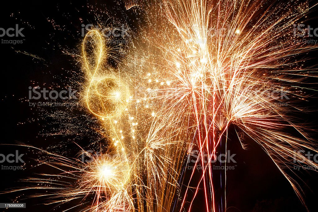 Sparkling Treble Clef With Fireworks Background royalty-free stock photo