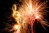 Sparkling Treble Clef With Fireworks Background