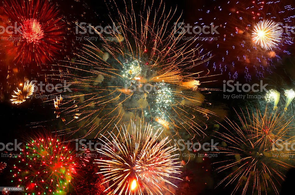 Sparkling volleys of fireworks stock photo