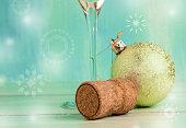 Sparkling wine cork on blurred festive New Year background