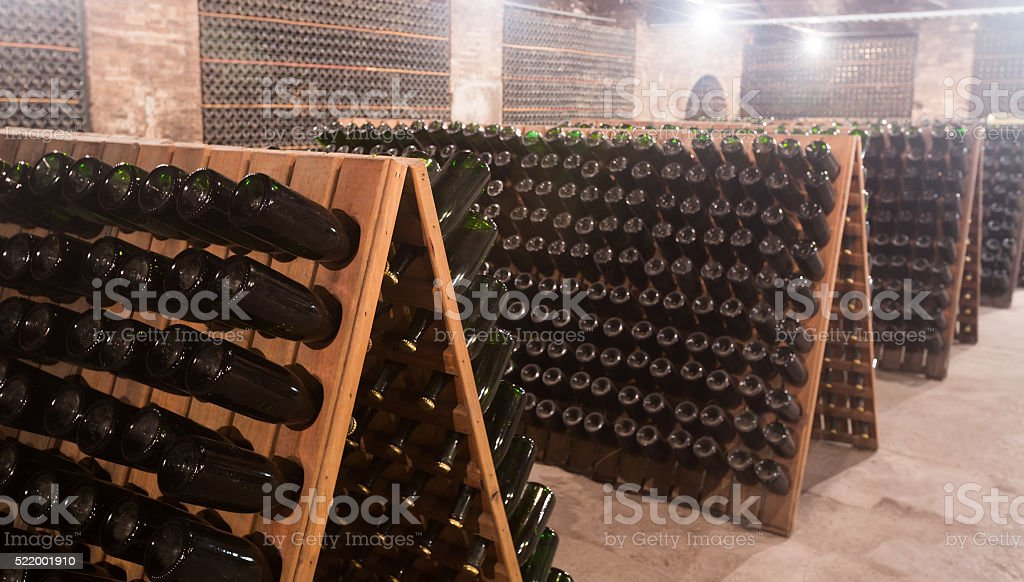 Sparkling wine storing for secondary fermenting in cellar stock photo