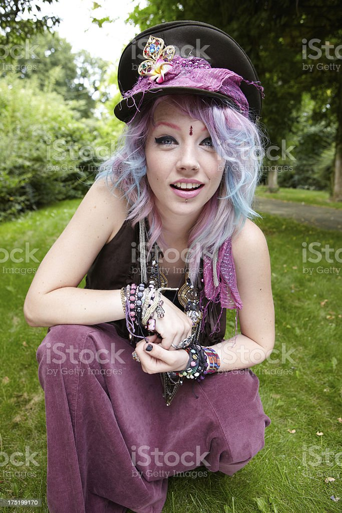 Sparkly young festival girl crouching royalty-free stock photo