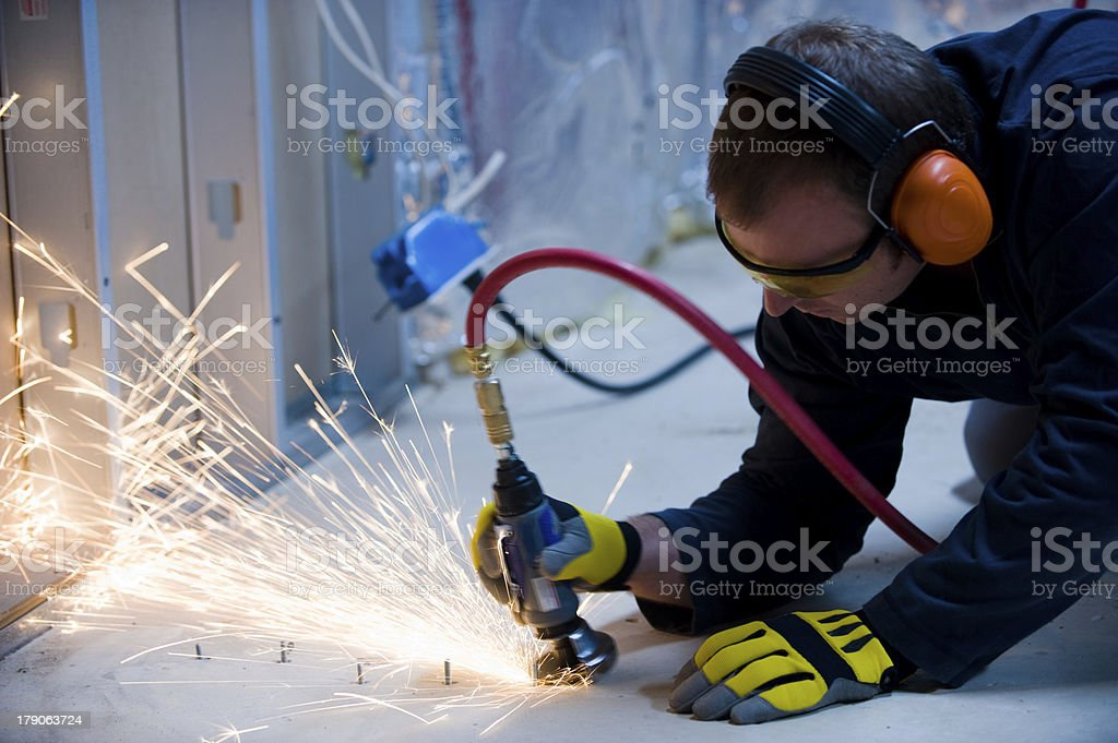 Sparks Fly as Worker Cuts Bolts stock photo