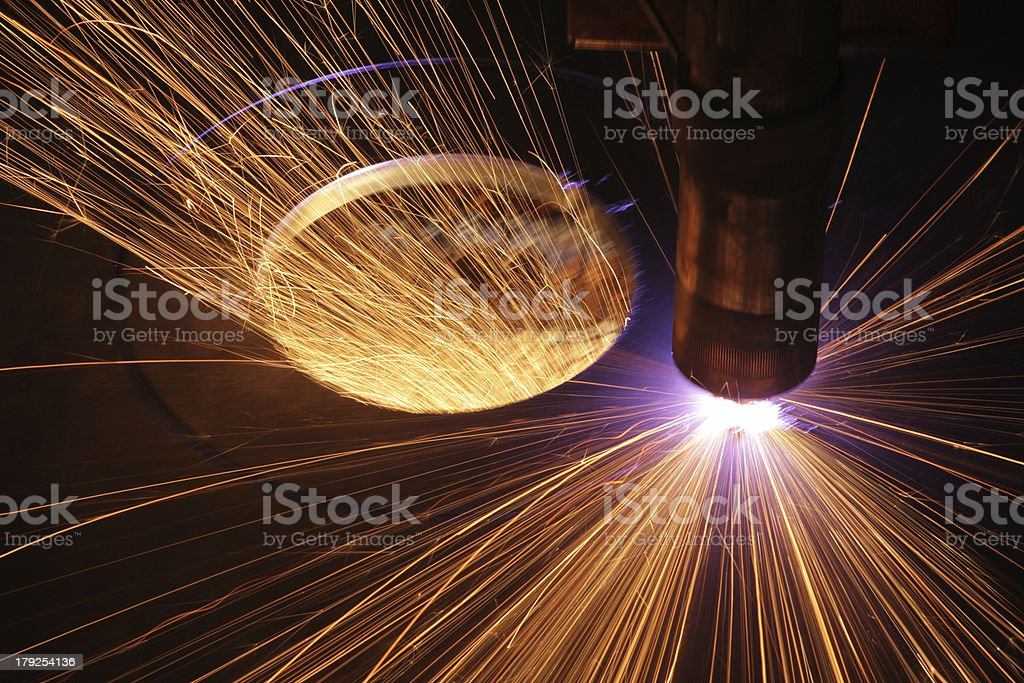 Sparks flying from welding machinery royalty-free stock photo
