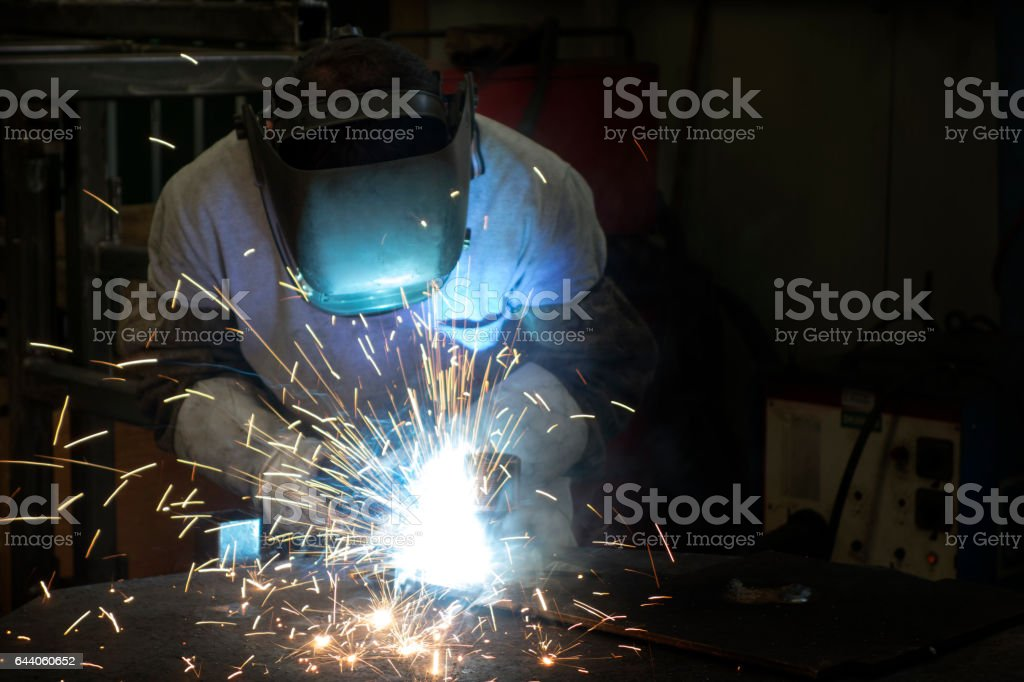 Sparks from a welder stock photo