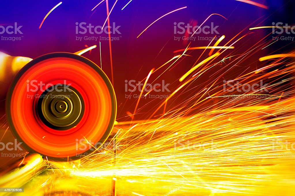 Sparks from circular saw. Metal sawing close up. stock photo